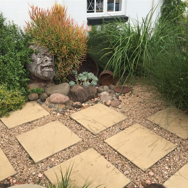 African-garden-3: An entrance garden using spaced paving inset with river gravel planted with Chondropetalum tectorum, Euphorbia tirucalli and Portulacaria afra in Hillcrest, KZN.