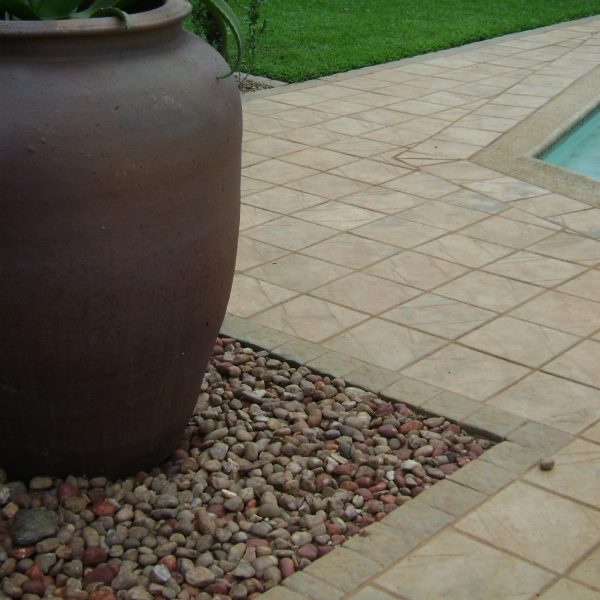 Contemporary-pot-paving: Pot feature and flagstone paving around swimming pool in Pietermaritzburg, KZN.