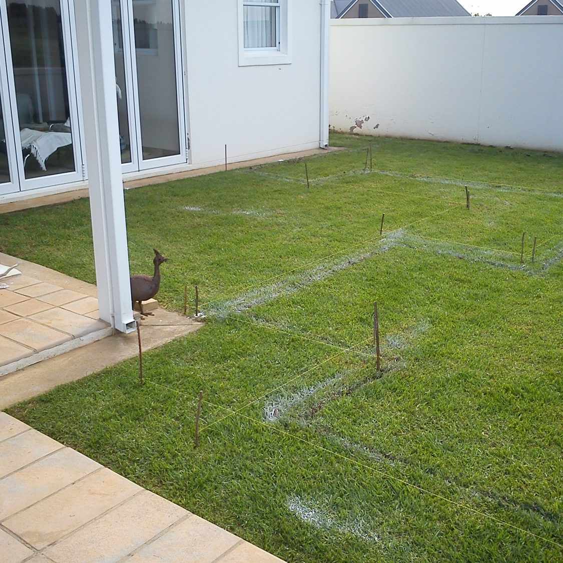 Contemporary-small-garden-2: Bespoke contemporary designed private garden in Garlington Estate in Hilton KZN, incorporating, Spaced flagstone paving with gravel and cobble edging.